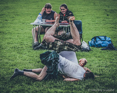 Don't Look Ladies! (FotoFling Scotland) Tags: scotland scottishwrestlingbond scottishbackholdwrestling stirlinghighlandgames wrestling athlete bag bendover bumup fall field kilt kilted ladies legs legsup male socks upkilt wrestler wrestlers