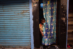 Peeking Boy (AdamCohn) Tags: india adam curtain peek mumbai slum slums cohn dharavi adamcohn wwwadamcohncom