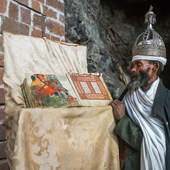 Ethiopian orthodox priest with an old bible in nakuto lab rock church, Amhara region, Lalibela, Ethiopia (Eric Lafforgue) Tags: africa people man color church silver square religious reading book clothing day adult african faith religion monk christian unescoworldheritagesite holy indoors monastery devotion bible civilization crown priest christianity shawl spirituality ethiopia oneperson developingcountry gez lalibela engravings hornofafrica geez ethiopian eastafrica orthodoxchurch abyssinia manuscripts traditionalclothing realpeople cavechurch adultonly onematuremanonly traveldestination 1people africanculture amhararegion ethio161329