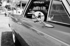 Mirror (AndreasGarcia) Tags: ca blackandwhite bw usa reflection film monochrome car analog 35mm photography mirror classiccar dof bokeh depthoffield chrome carshow selfie porterville cruisenight fujiacros100 canonefm originalphotography bokehlicious