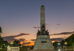 Sunrise at the Park (charlestheneedler) Tags: lunetapark philippineflag rizalmonument sunrise