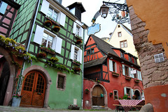 Another Beautiful Corner in Riquewihr (elfcvk) Tags: riquewihr colmar alsace france historic historical building architecture house half timbered green red yellow colorful color colour medieval history