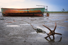 Anchored for the day (haqiqimeraat) Tags: bangladesh boat sea lowtide anchor anchored rust chittagong
