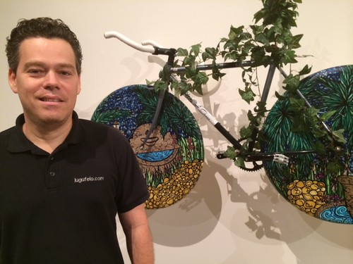 Sculptor Lugufelo at the Coral Gables Museum's opening night for the Art of bicycles exhibit
