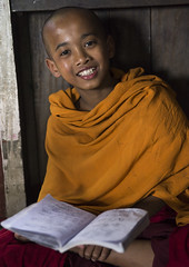 Young Novice Reading A Book, Mrauk U, Myanmar (Eric Lafforgue) Tags: school red people color colour male smile face childhood smiling vertical asian temple happy photography reading ancient education asia southeastasia day child classroom burma buddhist faith religion joy young culture monk buddhism class read monastery learning myanmar script shavedhead burmese elementary oneperson schoolbook novice rakhine mrauku arakan realpeople traveldestinations colorimage monkhood lookingatcamera waistup mrohaung rakhinestate 1people colourpicture religiousoccupation burma0395