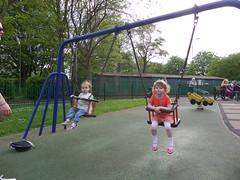 Swinging cousins (BuddaBoy) Tags: park amy swing robyn