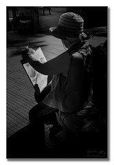 The artist (Descended from Ding the Devil) Tags: blackandwhite bw italy woman monochrome hat japanese artist outdoor sicily fullframe pinting cefal mirrorless sonyalphadslr sonya7mkii