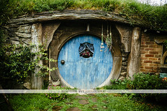 Hobbiton movie set - New Zealand (Naomi Rahim (thanks for 2 million hits)) Tags: newzealand nz 2016 northisland hobbiton matamata movieset movie set lotr lordoftherings thehobbit hobbit architecture house grass green colourful nikon nikond7000 travel travelphotography wanderlust door blue
