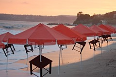 Storm in orange and grey (Wider World) Tags: sunset sea orange storm beach umbrella greece kefalonia kephalonia cephalonia ionian