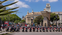 Lined up (NykO18) Tags: barcelona road street people sculpture españa plants bus tree art bike bicycle statue stairs person coach spain flora europe crowd steps scooter catalonia motorbike transportation workspace motorcycle manmade vehicle catalunya spectators cataluña offices plaçadecatalunya cataloniasquare