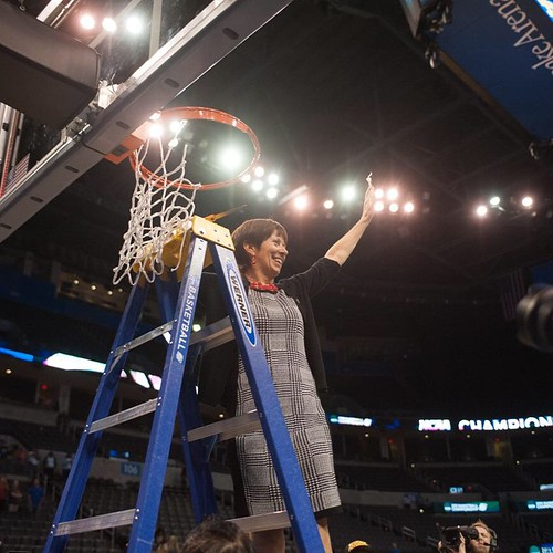 Irish head coach Muffet McGraw cuts down the nets after @ndwbb reached its fifth straight Final Four with a win over Baylor (photo credit: Jodi Lo | The Observer)