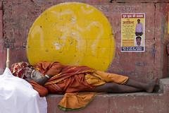 Sleeping Sadhu (Dick Verton ( more than 13.000.000 visitors )) Tags: travel sleeping orange india yellow colorful asia sleep streetlife streetscene varanasi sadhu streetshot