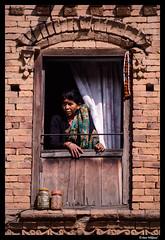 A kitchen window in Bhaktapur (Dan Wiklund) Tags: city nepal people woman window wall female person bhaktapur d800 2014