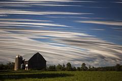 Whirlwind Farm (Matt Molloy) Tags: trees sky ontario canada motion strange field clouds barn landscape photography timelapse movement wind time violet warp hay lovelife mattmolloy timeslice
