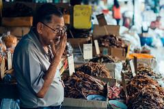 Squid (Mathijs Buijs) Tags: fish man rain canon thailand eos asia market bangkok stall squid vendor dried southeast raining 400d