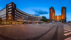 Panorama of Oslo Townhall and Fridtjof Nansens Plass in the Evening, Oslo, Norway (ansharphoto) Tags: city travel blue urban house building brick tower clock tourism oslo norway skyline architecture modern night facade dark square lights evening town hall twilight europe european cityscape exterior dusk cityhall capital landmark illuminated historic norwegian government townhall nordic scandinavia northern scandinavian radhuset guildhall radhus plass destinations administrative fridtjof nansens gildhall