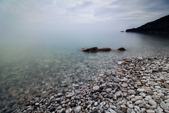 Ocean Mist at White Beach, Anglesey (natalie_thomas) Tags: landscape outdoor seascape wideangle wales whitebeach ocean water anglesey mist longexposure