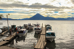 Panajachel Docks (enfys photography) Tags: trip travel vacation sky lake canon landscape volcano boat dock paradise guatemala adventure backpacking centralamerica panajachel t3i lakeatitlan enfys lakeatitln