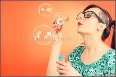 Portrait - Francy (Bubbles and Colors) (Robby Re) Tags: portrait woman color colors girl portraits glasses nikon colorful bubbles pop blow redhead colori occhiali soapbubble bolle femaleportrait colorato nikon70200 d700 nikond700