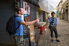 Showing You How It's Done (Chase Hoffman) Tags: street color building japan architecture umbrella shopping landscape fuji fujifilm okayama offcameralighting tdub chasehoffman tdub303 chasehoffmanphotography fujinonxf23mmf14r fujifilmxt10