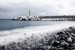 Untitled (NIOphoto.) Tags: ocean sea lighthouse seascape tower beach water stone landscape harbor nikon stones tokina madeira funchal ligh