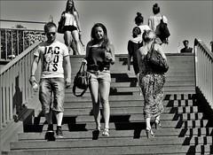 on the Stairs (heiko.moser) Tags: street city people bw woman streetart blancoynegro canon person mono blackwhite women leute noiretblanc candid strasse young teens streetportrait nb menschen teen sw mann monochrom publicity schwarzweiss nero youngwoman personen streetfoto einfarbig schwarzweis eyecatch entdecken streetfotografie heikomoser