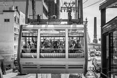 Incoming (John St John Photography) Tags: newyorkcity people blackandwhite bw newyork blackwhite child manhattan streetphotography tram queensborobridge rooseveltisland candidphotography secondave e60thst peopleofnewyork