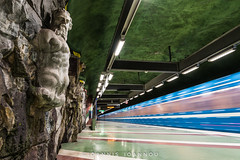 Kungstrdgrden Metro Station in Stockholm, Sweden (Ioannis Ioannou Photography) Tags: fluorescentlights kungstrdgrden metro scandinavia door lights elevator blue ioannisioannouphotography art statue photography red green stockholm train escalators station sweden sverige tbana