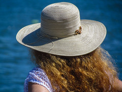 Camera Shy? (tquist24) Tags: blue summer portrait woman beach water girl hat fashion canon wow hair outdoors wanda bokeh connecticut candid newengland longislandsound
