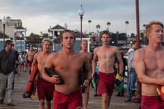 Oceanside Lifeguards (EthnoScape) Tags: oceanside california cityofoceanside lifeguard lifeguards oceansidelifeguard oceansidelifeguards oceansidepier lifestyle training jump assistance drown drowning surf surfer surfers surfboard lifesaver lifesavers rescue rescuer rescuetube rookie swim swimming swimmer swimmers athlete athletic health fitness youth boardshorts bikini wetsuit neoprene danger riptide ripcurrent red yellow baywatch fins swimfins tower lifeguardtower beach shore ocean water safety tourist touristseason jetski summer stock ethnoscape ethnoscapeimagery