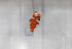 Tomas (GavMcCourt) Tags: performance art creative perform performing male man aerial perspective above aerialview lookingdown looking down downwards microphone colour color orange satin material portrait portraiture portraitphoto environment environmental environmentalportrait studio exhibition glasgowschoolofart gsa gsofa designer artist