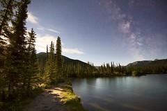 Moonlight stroll (John Andersen (JPAndersen images)) Tags: alberta clouds forgetmenotpond july kananaskis milkyway mountains night pond summer
