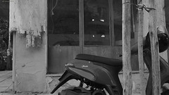 The corner. (df-stop.) Tags: tree abandoned window shop corner reflections closed samsung greece macedonia thessaloniki torn parked moped timeless unused baw tatters μακεδονια eurocrisis macedoniatimeless