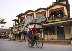 Old Colonial Houses And Stores, Thandwe, Myanmar (Eric Lafforgue) Tags: street city house color colour building men bicycle shop horizontal architecture facade outdoors photography store asia closed day adult burma colonial citylife myanmar fullframe adults 2people twopeople adultsonly oldfashioned birmanie thandwe menonly colonialbuilding traveldestinations colorimage  birmania mianmar colonialstyle buildingexterior   rakhinestate   barma  mianm  builtstructure  colourpicture    birmanya    mjanmar mjanmarsko pa burma0284