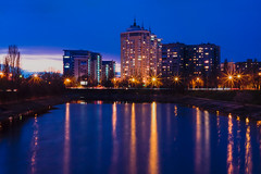 Rusanivsky channel (Wolfhowl) Tags: pink blue sunset reflection buildings river lights spring dusk ukraine april kyiv dni 2015 україна dnieper dnipro київ rusanivka русанівка