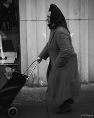 That's Life (whistlingtent) Tags: street old woman white black shopping newcastle mono trolley tyne
