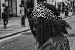 IMG_5131-Edit - Bandana (roger_thelwell) Tags: life street city uk winter portrait england people urban bw white black streets cold london lamp monochrome westminster beauty hat rain leather mobile umbrella hair bag walking real photography mono chat shiny phone traffic post natural photos britain circus cigarette candid cab taxi great sac hats cell photographic smoking lamppost photographs oxford conversation shiney bandana talking shoulder handbag stud speak speaking studs commuters