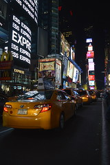 Times Square Cabs (tannerstakesphotos) Tags: usa newyork night lights evening neon manhattan cab taxi taxis timessquare cabs advertisements