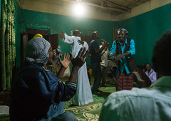 Sufi people go into a trance during a ceremony, Harari region, Harar, Ethiopia (Eric Lafforgue) Tags: world africa travel people color men green horizontal night religious outdoors togetherness dance clothing women worship singing dancing african muslim islam religion praying group performance performing ceremony dancer unescoworldheritagesite celebration indoors event spirituality ethiopia sufi sufism adultsonly trance hornofafrica chanting eastafrica harar abyssinia fulllenght harari harariregion groupeofpeople ethio163019