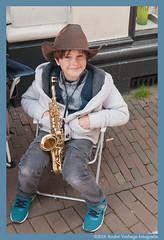 having a break (jada photography) Tags: boy haarlem hat child instrument sax saxofoon