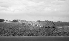 Deseret_Leavitt008 (deseretleavitt) Tags: water photography cloudy wheels sprinkler farmer assignment2