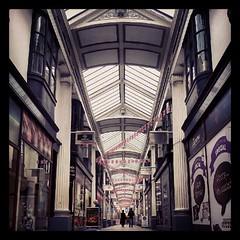 Lower arcade, Broadmead. Three upper one... (jules hynam) Tags: old bristol arcade victorian flags shops quaint broadmead uploaded:by=flickstagram instagram:photo=25349051309770662332916970