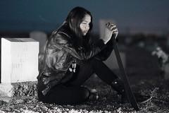 Somber (em_burk) Tags: canon arizona grahamcounty graveyard machete girl woman dark black blue leather steel bluehour tomb headstone ground boots