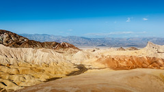 Death Valley - Zabriskie Point (uwe.werling) Tags: world california travel blue sky orange nature weather stone clouds point landscape death sand nikon rocks flickr desert hiking no ngc wide award human valley ng traveling zabriskie uwe 1635 d700 werling 1635vr
