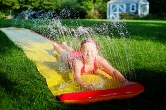 Slip 'N Slide into Summer Fun (DHaug) Tags: summer wet water grass yard droplets outdoor sunny september velvia fujifilm splash summerfun slipnslide coolingoff xe1 2013 xf35mmf14r