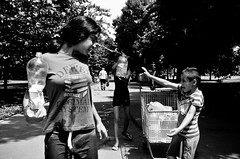 This is What it Means to Have a Family (stimpsonjake) Tags: city summer blackandwhite bw water monochrome kids play candid streetphotography romania bucharest 185mm nikoncoolpixa