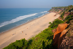 View Varkala Beach (marina.murger) Tags: ocean travel blue trees sea summer sky cloud sun sunlight india seascape color green tourism beach nature beauty horizontal palms outdoors see bay coast landscapes sand rocks asia surf view image top indian tide extreme down kerala scene varkala cliffs edge tropical waters coastline shrub idyllic vacations climate tranquil scenics locations destinations boundless