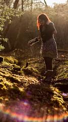 Laura by the stream (digitalctzn) Tags: trees tree green forest lens log woods stream glare guitar magical lensglare wunderlust