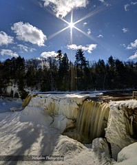 Fighting the sun (Notkalvin) Tags: ice frozen waterfall michigan falls waterfalls solarflare tahquamenon tahquamenonfalls upperfalls shootingintothesun mikekline michaelkline notkalvin takingpictureswithmywife notkalvinphotography