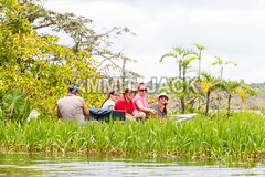 Boat with tourists in Amazonian jungle (Globetrotter Jack) Tags: park trip vacation people lake holiday fish green tourism southamerica field river boat photo nationalpark ecuador fishing amazon rainforest day tour outdoor wildlife famous group young reserve peaceful lagoon tourist canoe exotic jungle agency vegetation destination tropic service stick raft guide wilderness premium reservation piranha cuyabeno lowangle amazonia angler macrolobium